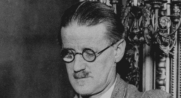 "** TO GO WITH STORY TITLED POETS AND PUBS** FILE** Author James Joyce is shown in this undated file photo in Dublin. Joyce, who knew every street in his ""dear, dirty Dublin,"" would be surprised to find himself, a trifle larger than life, squinting out from under a jaunty fedora and leaning on a gentleman's walking stick, right in the heart of the metropolis. (AP Photo)"